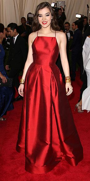The Most Jaw-Dropping Dresses at the 2015 Met Gala | HAILEE STEINFELD | in a simple, elegant red halter gown with twin gold cuffs and glossy red lips.