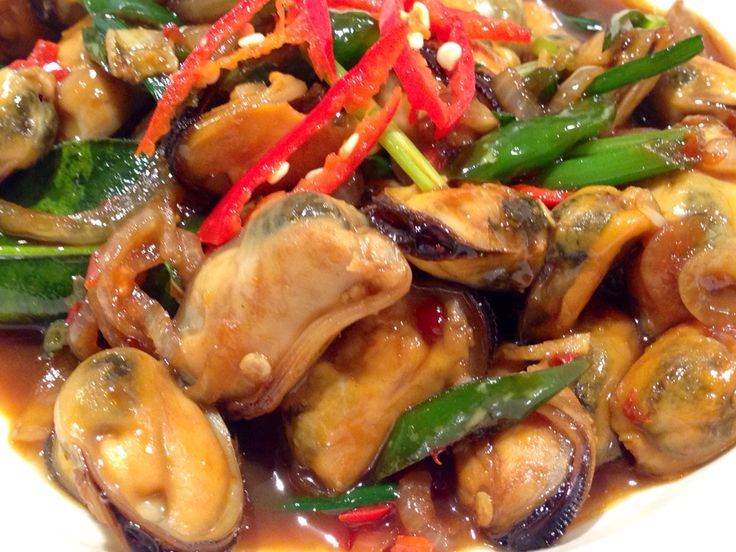 Stir fried mussels with chilli padi and a dash of dark soy sauce