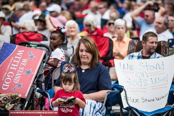 Karen Owen and her daughter Micaiah join thousands of Christian supporters at the We Stand with God, Pro-Family Rally Saturday at the South Carolina Statehouse. Speakers included presidential hopefuls Ted Cruz and Rick Perry and U.S. Senator Tim Scott of South Carolina.