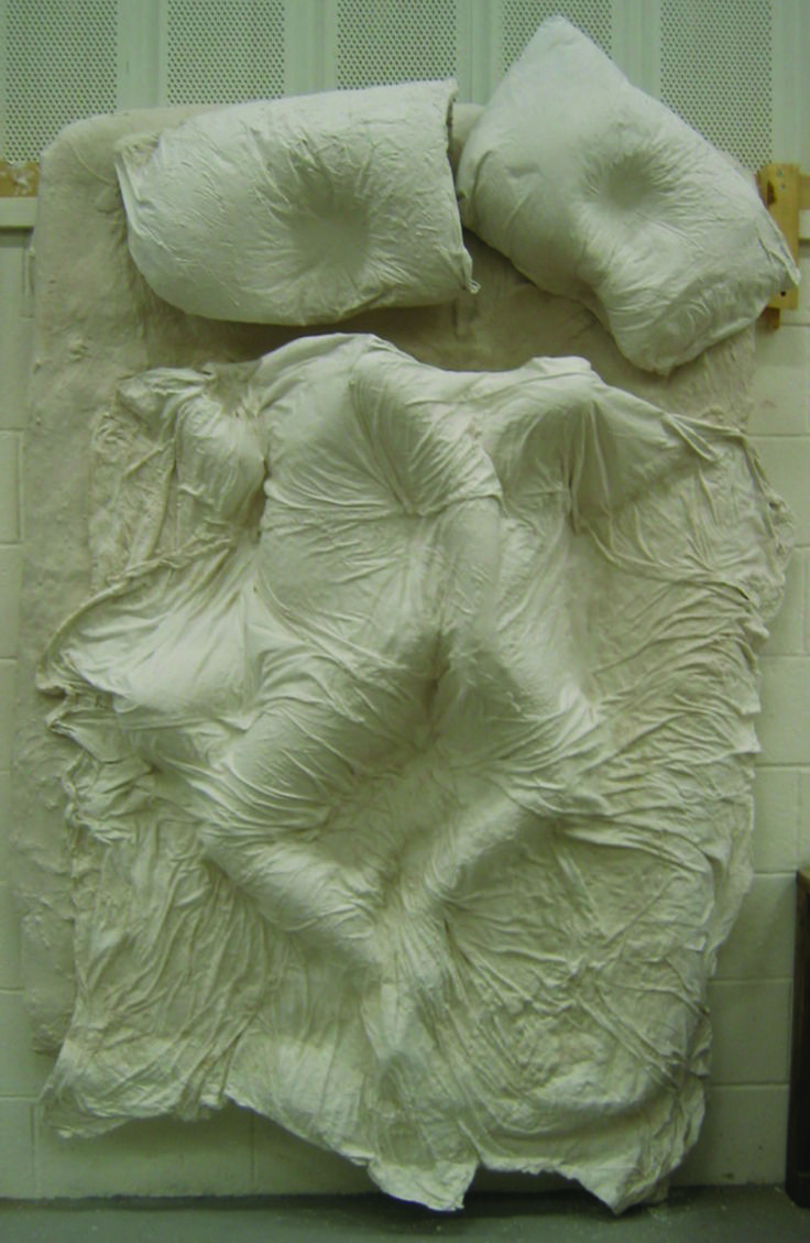 'The Life and Death of a Relationship'        Sue Law. 2007. This life sized bed has the impressions from a pair of lovers sleeping together. This is one stage of 10 different pieces showing the stages of a relationship from the positions of the lovers in bed. Plaster, Blankets, Sheets, Wood.