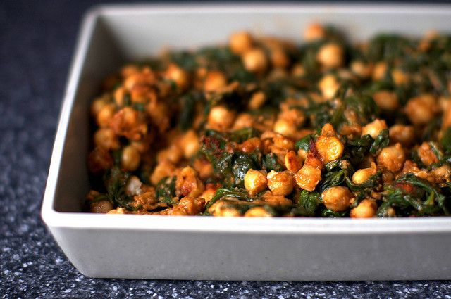 spinach, garbanzos, tomato and spice by smitten, via Flickr - This is being paired up with some nice white fish this evening...