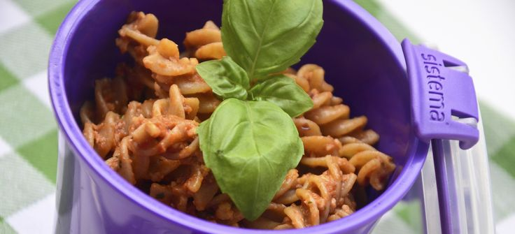Pasta with red pesto with almonds and dried cranberries