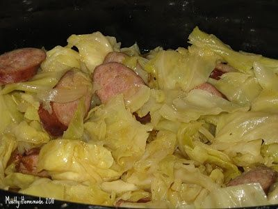 Crockpot Cabbage and Sausage recipe: lg Head cabbage(quartered & stem removed), 1 lb smoked sausage, 1 stick of butter, 1 onion, salt & pepper, 1/4c. water...layer cabbage, sausage, onion & butter; repeat until you've used it all. Salt & pepper to taste, then pour water over top. cook 4 hours on high. Stir occasionally. (author serves w/pan of homemade mac & Cheese or/& pan of cornbread