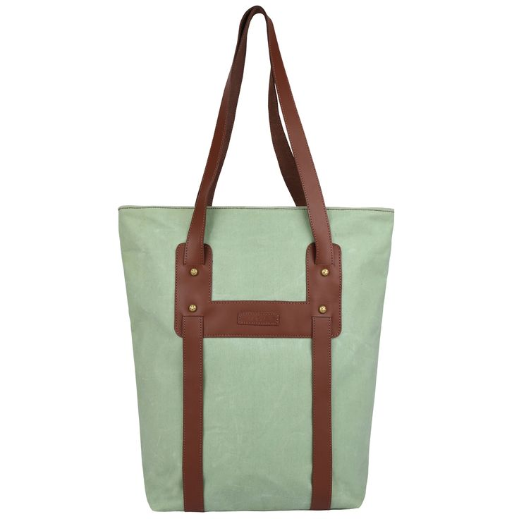 Stylish and trendy, this tote bag is made of waxed canvas with a vegan leather look handle and YKK zipper closure with a contrast lined interior to complete your look.