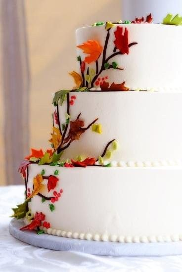 Fall wedding cake idea - white buttercream frosted wedding cake with cascading autumn leaves {Cakes for Occasions - Boston Cakes}