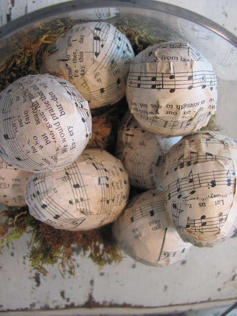 plastic Easter eggs wrapped in sheet music.
