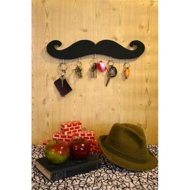 "Someone please tell me why mustaches are so ""in"" - the new bacon"" - or why a tennis ball would make a ""lovely"" key holder. The thing is, I don't see actual mustaches like this coming back . . . . but then again, I don't live in NYC."