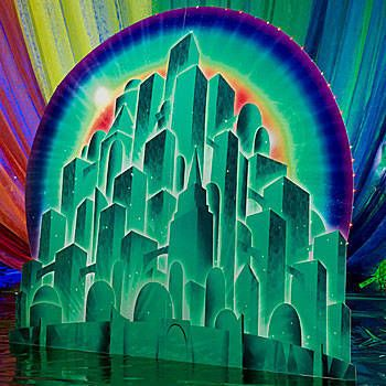 The Emerald City Background shows off the mysterious city of green with a fantastic rainbow in the background with light accents