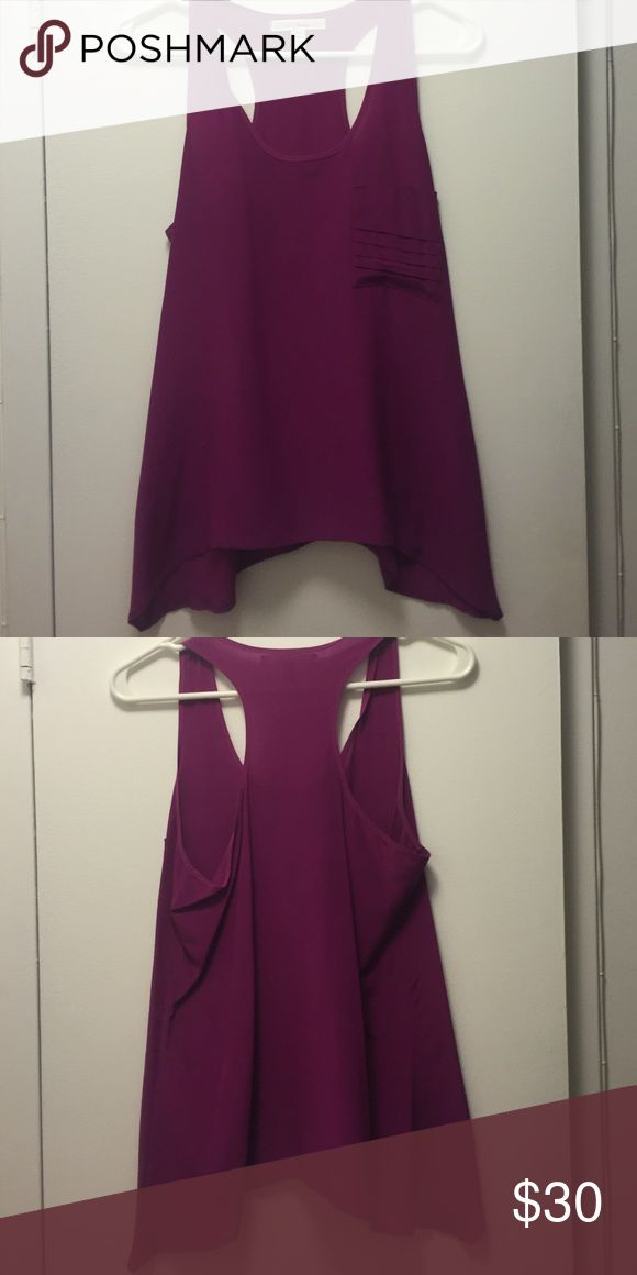 Purple Scrappy Cami Beautiful purple strappy Cami. Fits true to size. Looks great when paired with a black skirt or black jeans. Perfect for more casual work environment or going out! Tops Blouses