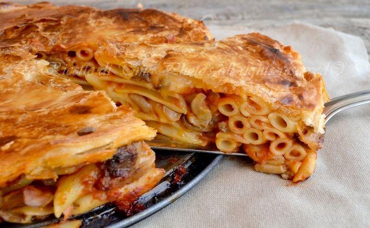 Timballo di pasta con funghi e mozzarella,una ricetta adatta per le feste,ricca e sostanziosa