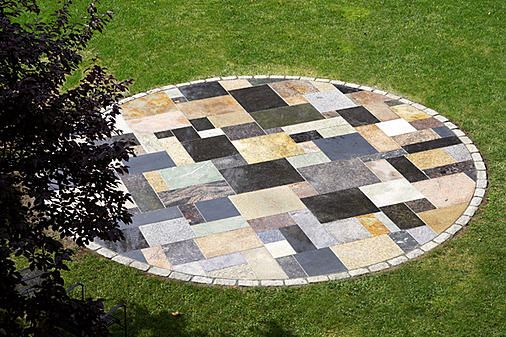 Beautifuly done granite scrap patio. I'm in the middle of a project doing this and its a lot more work than I was expecting. Free materials though.