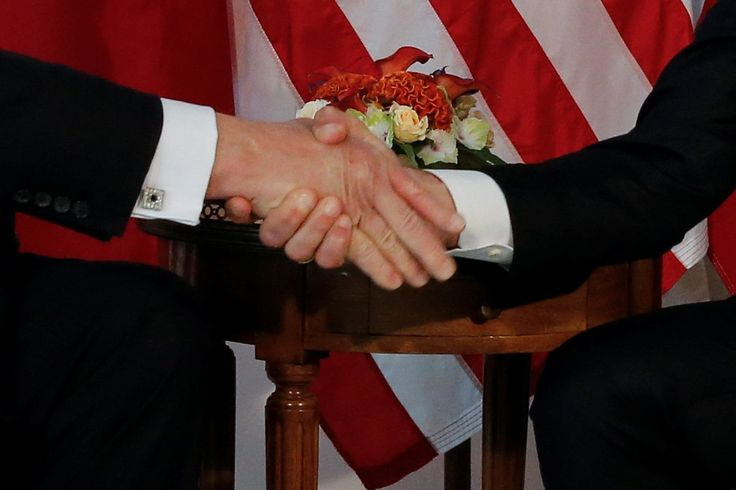 trump macron handshake