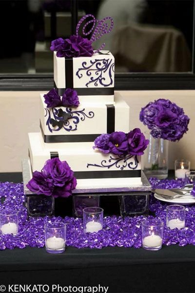 This 3 tiered squared wedding cake, with detailed designs and floral accents adds a very nice and elegant touch. (Detailing of the cake for my dream wedding would be in green with the purple flowers).