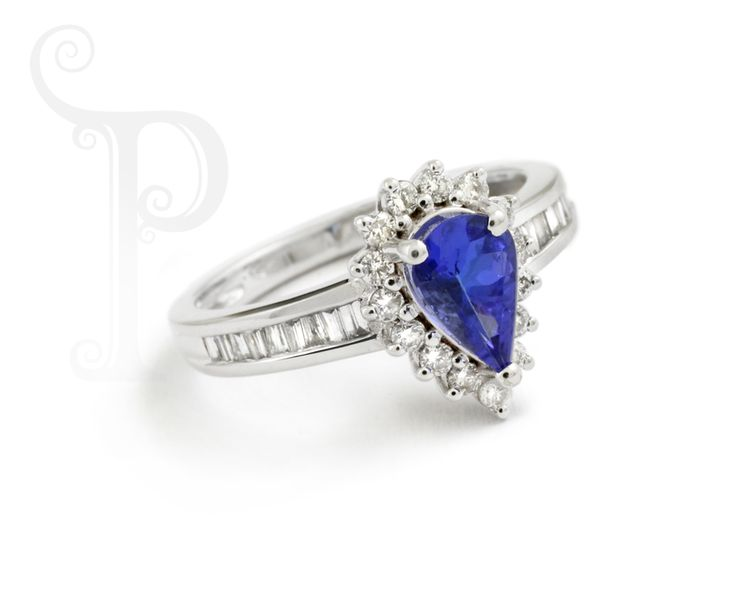 Custom made 18ct White gold Ring, Set With A Pear Cut tanzanite and Round Brilliant Cut Diamonds