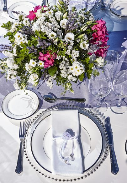 Floral centerpiece and table setting in lavender hues