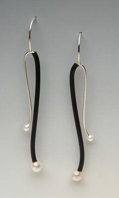 Neoprene tube  over the metal. Silver & Black Swoop Earrings: Lonna Keller: Silver, Pearl, & Neoprene Earrings - Artful Home