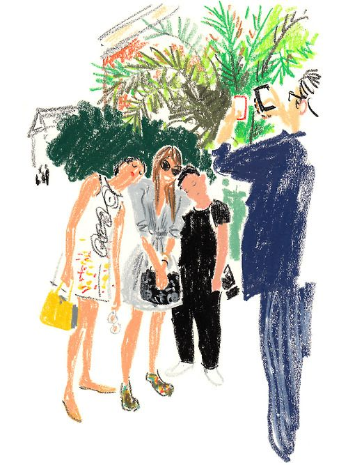 Giovanna Battaglia and Tommy Ton Using Anna DelloRusso's extra puffy shoulder pads as pillows + Phil Oh, photographer, taking pictures with their phones Orangerie Férou, Jardin du Luxembourg, Oct. 1