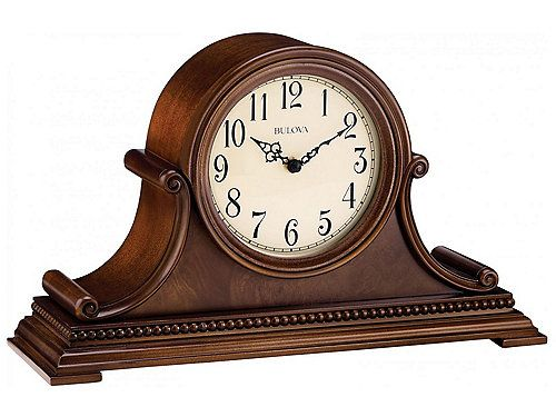 """Featuring a bent hardwood case and a brown cherry finish, this decorative Asheville mantel clock with detailed accents is classically stunning. It features wooden bezel and full scroll case design with traditional Arabic numerals with metal filigree hands. Adjustable volume control and automatic night shut-off switch options are available.  L: 14.5"""" x W: 5.3"""" x H: 22.8"""" SKU: 175318230   ON SALE $187.46 Was $249.95"""