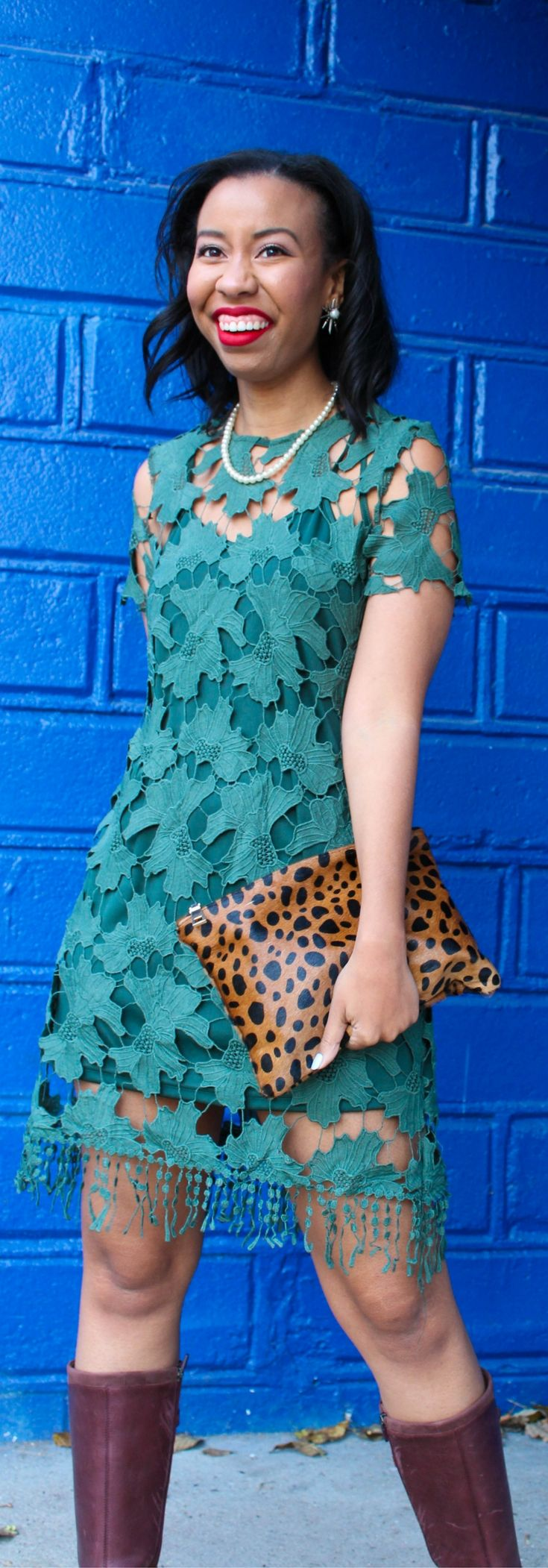 Looking for a dressy casual fall outfit for Thanksgiving? Style blogger features a fall green lace dress from Shop the Mint that fits the bill. // how to wear a lace dress, riding boots outfit idea, fall date night look