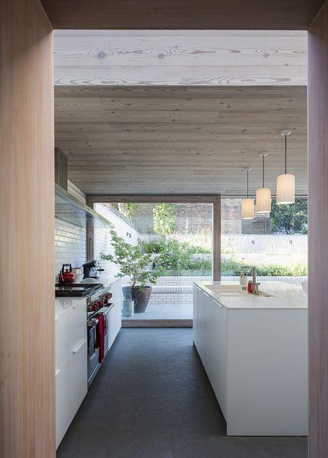 http://www.dezeen.com/2013/03/14/east-london-house-extension-larch-glass-pale-brick-david-mikhail/