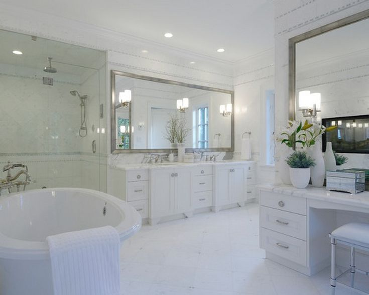 An All White Bathroom Makes The Perfect Canvas For A Bainultra Freestanding Bathtub Bathroom Mirror With Lightsshower