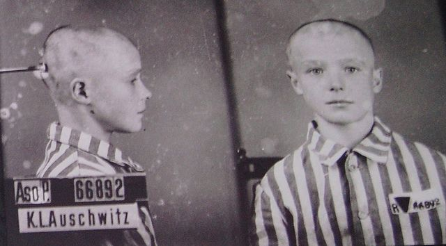 """Lisin was a 13 year old Russian Jew  who was brought to Birkenau through the infamous """"Gates of  Death"""" via train on February 10, 1942.  His official fate remains  unknown; however, he likely perished in the gas chamber soon after  this mugshot was taken.  This boy would have been considered a  """"double enemy"""" to Adolf Hitler because he was both a Russian  and a Jew."""