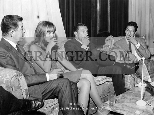 This is a Granger licensable image titled 'LA SEMAINE DU CINEMA FRANCAIS IN 1964. The week of the french cinema in Madrid with Jean Servais, Francoise Dorleac, Philippe de Broca and Gerard Barray on february 19th, 1964. Full credit: AGIP - Rue des Archives / Granger, NYC -- All ri. ' by GRANGER All rights reserved. You may not copy, publish, or use this image except for sample layout ('comp') use only. You must purchase the image from Granger in order to use it for ANY o...