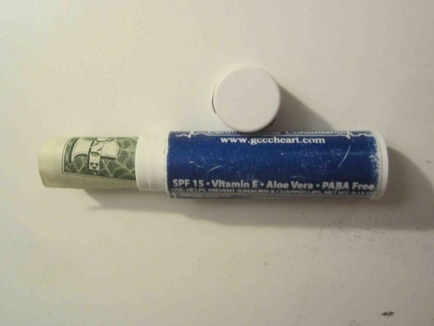 Stash extra cash in an empty lip balm. | 13 Travel Tips That Will Make You Feel Smart