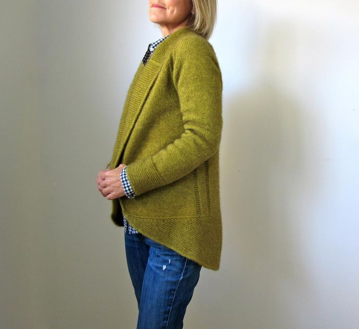 """What I had in mind was a cozy, modern cardigan with some positive ease, a generous collar, made long enough to wear comfortably with 'slim' pants or leggings and boots. But as the design progressed, I realized a shorter version - more like a neat little riding jacket - would also look great. So, a short option is included in the pattern too. The rounded """"coat tail"""" reminds me of a conductor's jacket; hence the name Maestro! It is constructed all in one piece, top-down. Other than seaming…"""