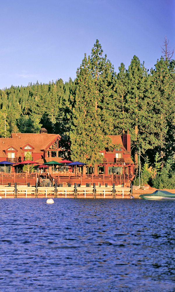 There are plenty of inexpensive places to stay on Lake Tahoe—but in many of them, you'd be too afraid to get beneath the sheets. These four clean, inviting lodges are the exception. They manage to combine value, location, and quality for travelers who want to live large on a budget.