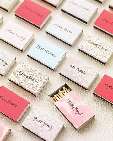 Wedding favors as escort cards: wrap matchboxes or votives with pretty paper and handwrite your guests' names on them.