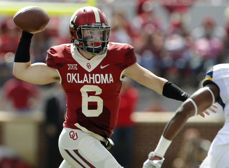 Oklahoma's Baker Mayfield (6) looks to pass during a college football game between the University of Oklahoma Sooners (OU) and the West Virginia Mountaineers (WVU) at Gaylord Family-Oklahoma Memorial Stadium in Norman, Okla., on Saturday, Oct. 3, 2015. Photo by Bryan Terry, The Oklahoman
