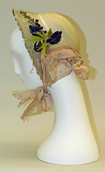 Straw bonnet with silk ribbon and velvet artificial flower trim, American, 1863.