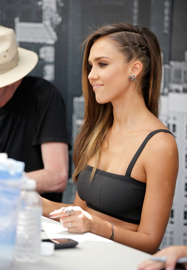 tight side-braid on #JessicaAlba. Cool way to give the feel of shaving a side of her head without committing to actually shaving it!