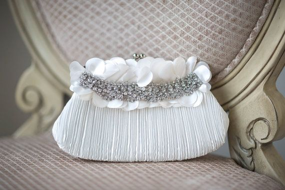 BRIDAL CLUTCH    - Crinkled ivory satin  - Rhinestone embellishment  - Silver metal frame and clasp  - Satin lined with small pocket inside  -