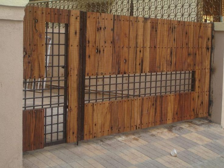 Wood iron gates art wood iron ironguys main gate for Wooden main gate design
