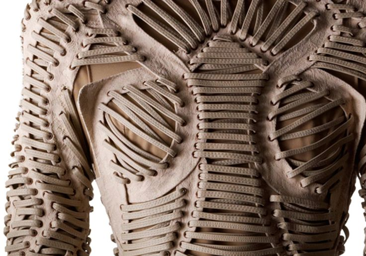 Fabric Manipulation - cutout leather bodice with lace-up structure; sewing; creative fashion detail // Iris Van Herpen