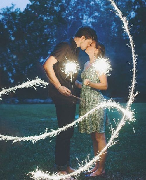 Electrifying kiss love couples kiss night outdoors fireworks engagement photogrpahy