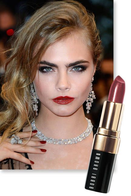 Beauty trend: Dark glossy lips, as seen on Cara Delevingne