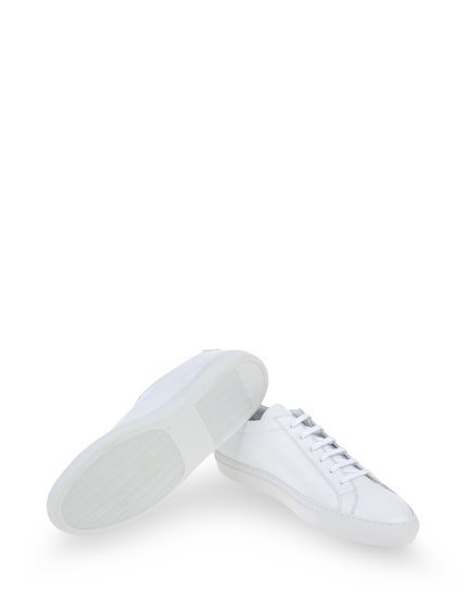 Common Projects Low Tops & Trainers Men - thecorner.com - The luxury online boutique devoted to creating distinctive style