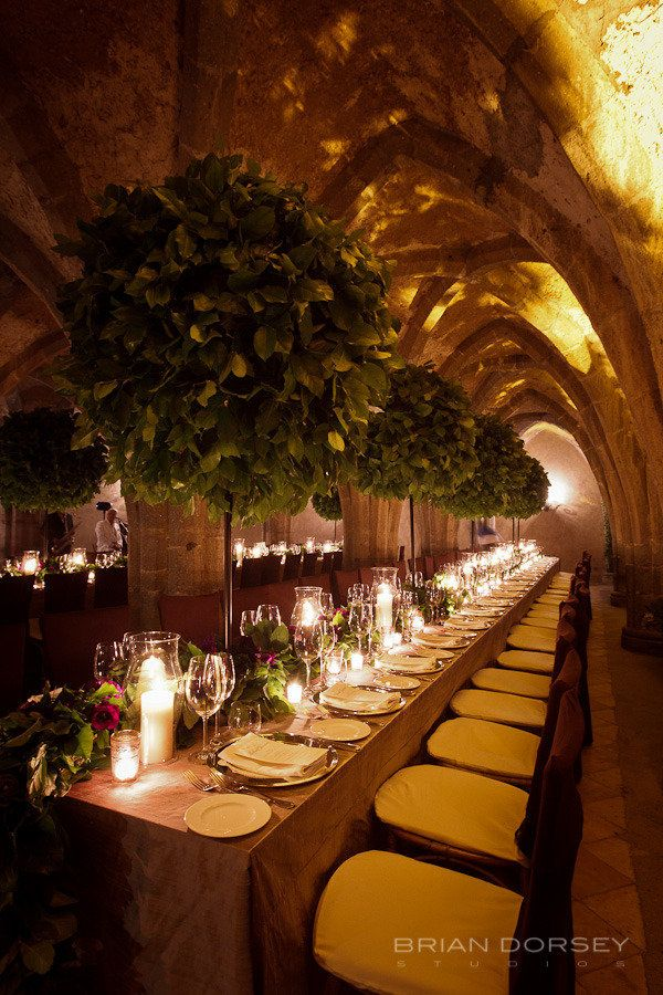 I like the garland & flowers as a long table runner with the variations in the candles. Do not like the trees.