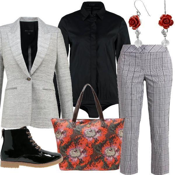 Pantaoni a quadretti e un tocco di colore nella borsa a fiori, abbinati ad una camicia body nera , una giacca grigio perla , stivaletti lucidi neri e un bel paio di orecchini, Si consiglia di aggiungere una mantella o un cappotto.
