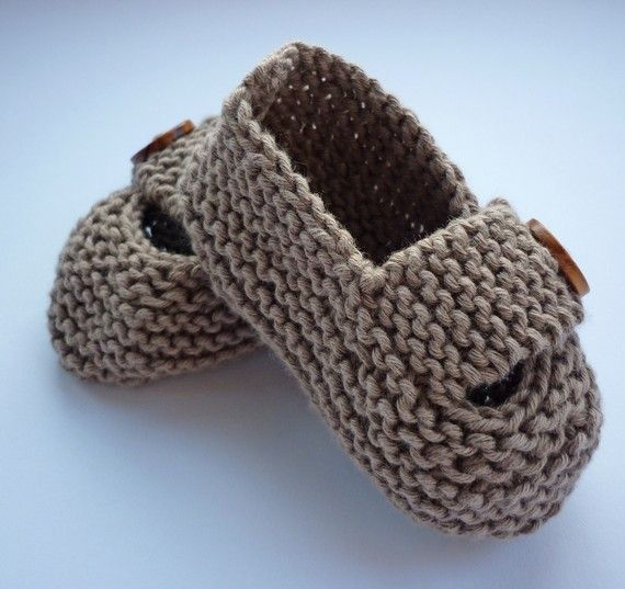 Little grey baby shoes. Knitted with love.