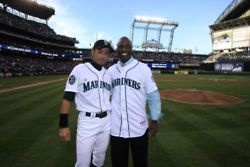 Ichiro was on the receiving end of Mike Cameron's ceremonial first pitch. — at Safeco Field.