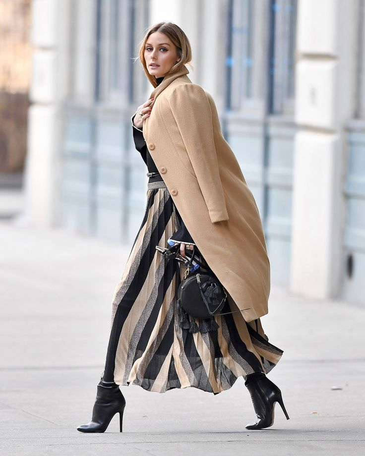 A tan overcoat by Related Apparel provided a nod to menswear tailoring, though underneath her coat the silhouette was decidedly feminine, thanks to her sky-high Jimmy Choo booties and a thin waist-cinching belt from Reiss. The finishing touch? An eye-catching, tassel-trimmed Rebecca Minkoff bag.
