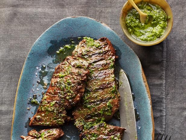 Pesto Steak : Mix 1/4 cup pesto, 2 tablespoons white wine vinegar and 1 tablespoon hot water. Grill or broil 1 1/4 pounds skirt steak; brush with the pesto.