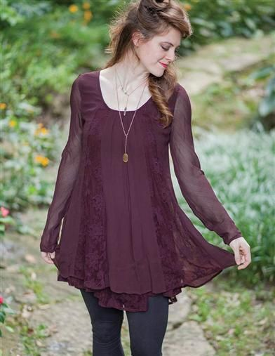 Fluid grace tunic panelled with embroidered netting overlie an airy cotton shift.