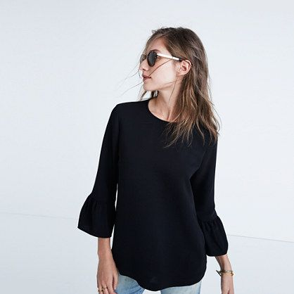 The perfect combo of sleek and swingy, this effortless crepe top has fluttery bell sleeves. Try it with a lean skirt for the office or with jeans for after. <ul><li>True to size.</li><li>Poly.</li><li>Machine wash.</li><li>Import.</li></ul>