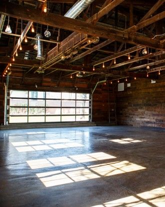 Restored Warehouses Where You Can Tie the Knot - Just 25 miles from downtown Austin, The Union on Eighth may look like an abandoned warehouse, but that metal exterior signals its rich past as a blacksmith post, Oldsmobile dealership, and transmission shop.