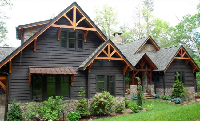 Paint black. Add detail at roof line. tin roof awning!!!! 15 Modern Rustic Homes with Black Exteriors | upcycledtreasures.com